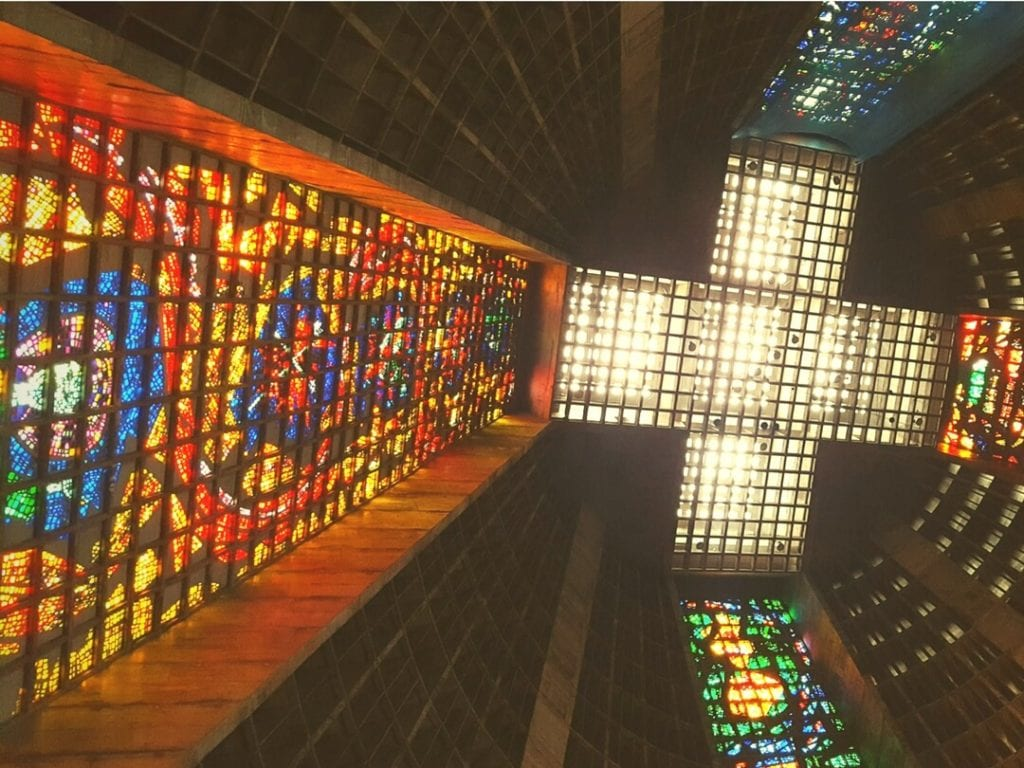 A photo of the colourful stained glass interior of Saint Sebastian Cathedral, Rio
