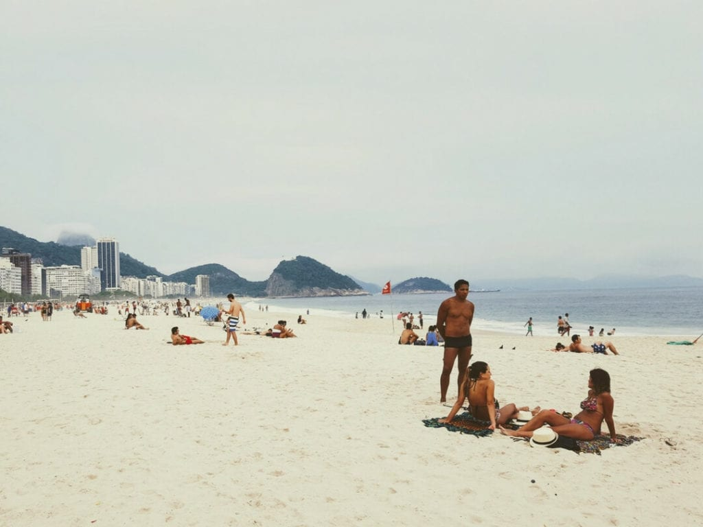 Sunbake on Copacabana with the locals