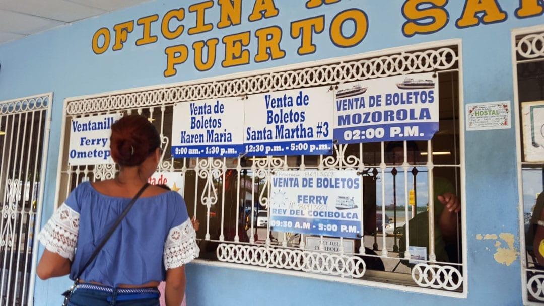 Woman-buying-Isla-de-Ometepe-ferry-tickets