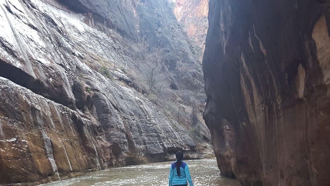 woman-walking-alone-river