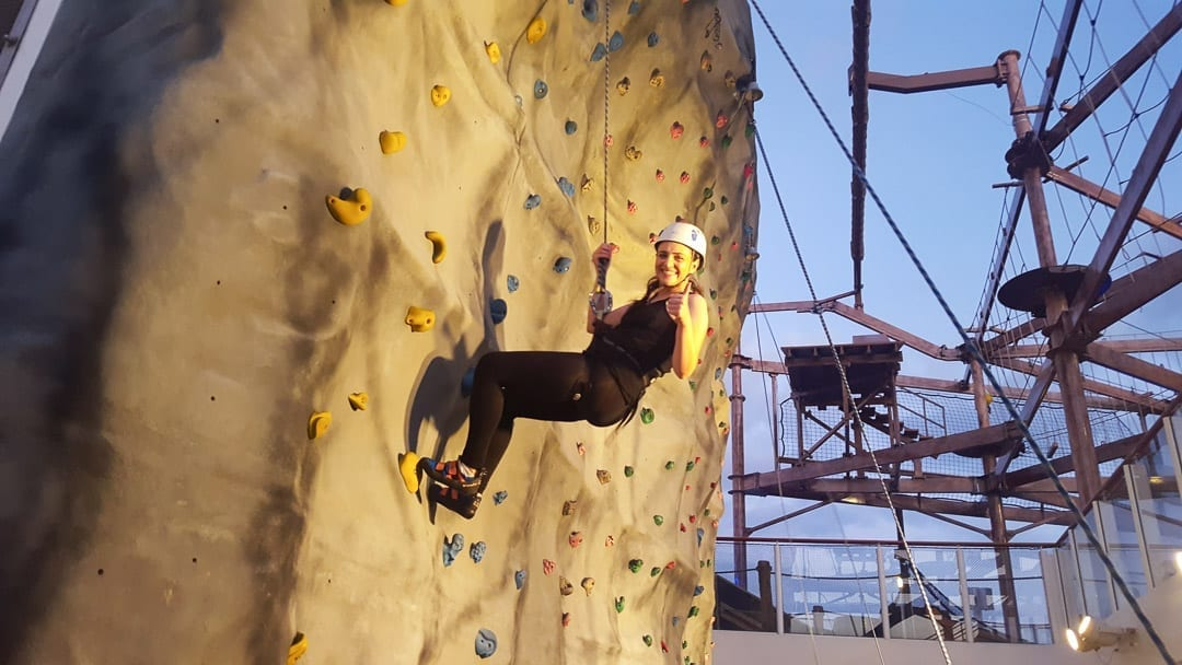 woman-rock-climbing-on-norwegian-getaway-cruise