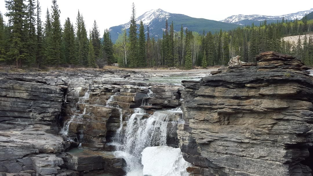 spring-snow-athabasca-waterfall-jasper-canada