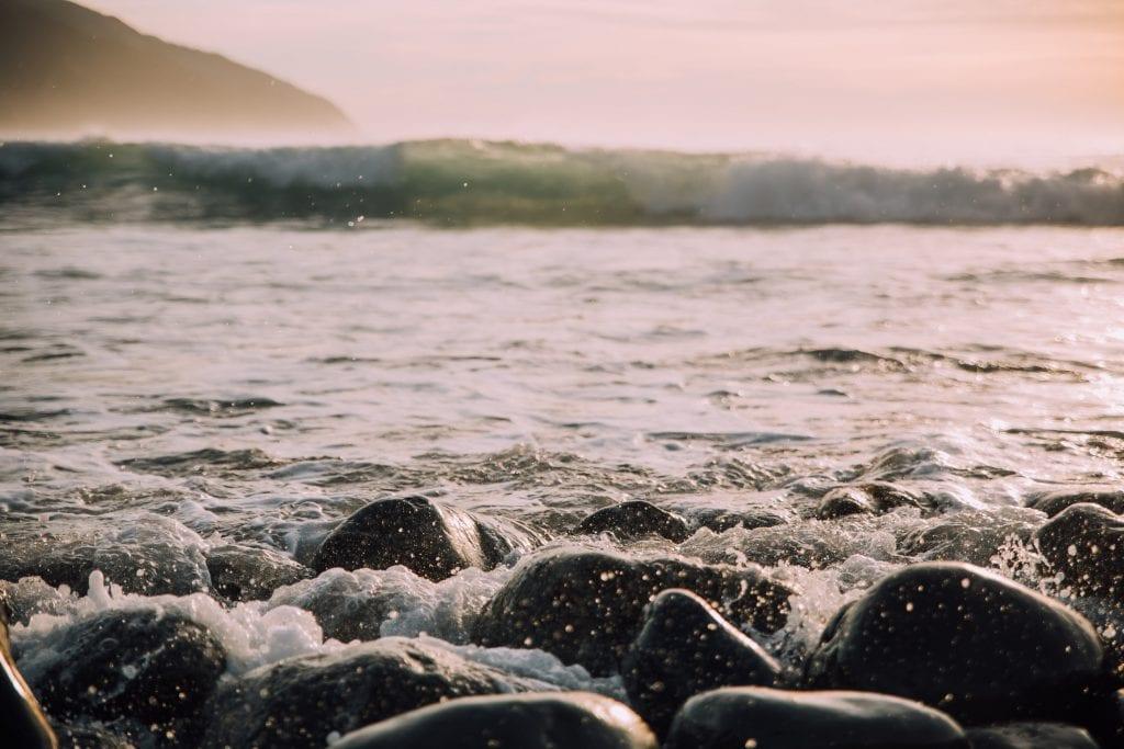 black-pebble-beach-in-kaikora-new-zealand